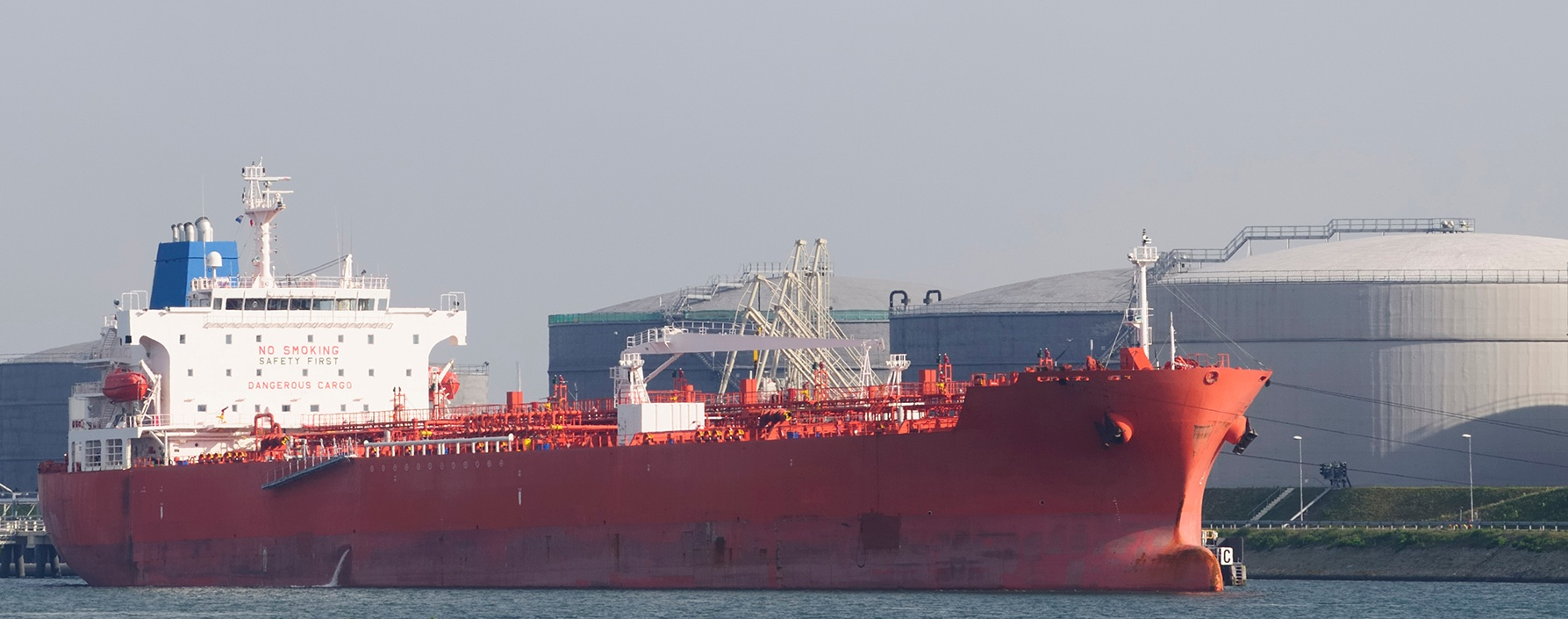 Cargo ship near oil storage