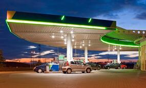 green gas station at night