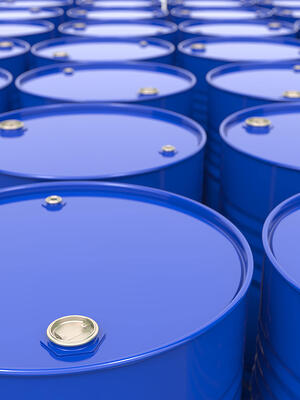 Industrial Background with Blue Oil Barrels